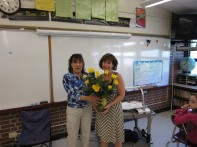 Elizabeth Presenting Flowers to Winner of Teacher Appreciation Day Essay Contest from Apple Creek Flowers!