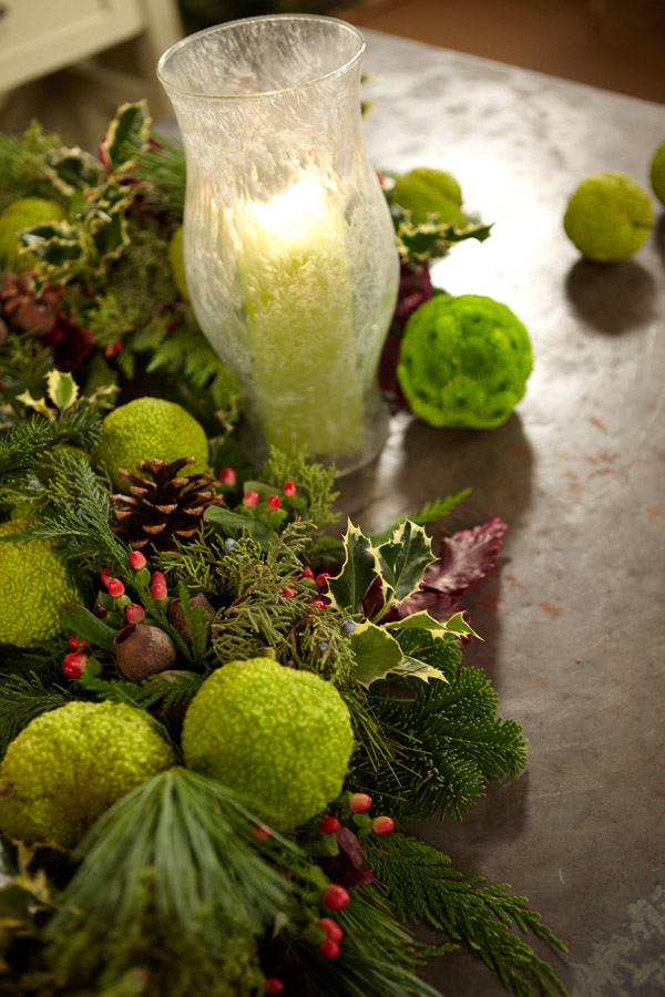 Click on this picture to watch the video on making a split wreath centerpiece with Hedge Apples and Frosted Hurricanes on Fun with Flowers and J!